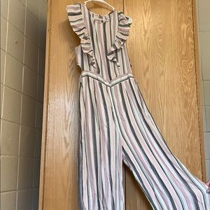 Pink grey & white jump suit with ruffled front